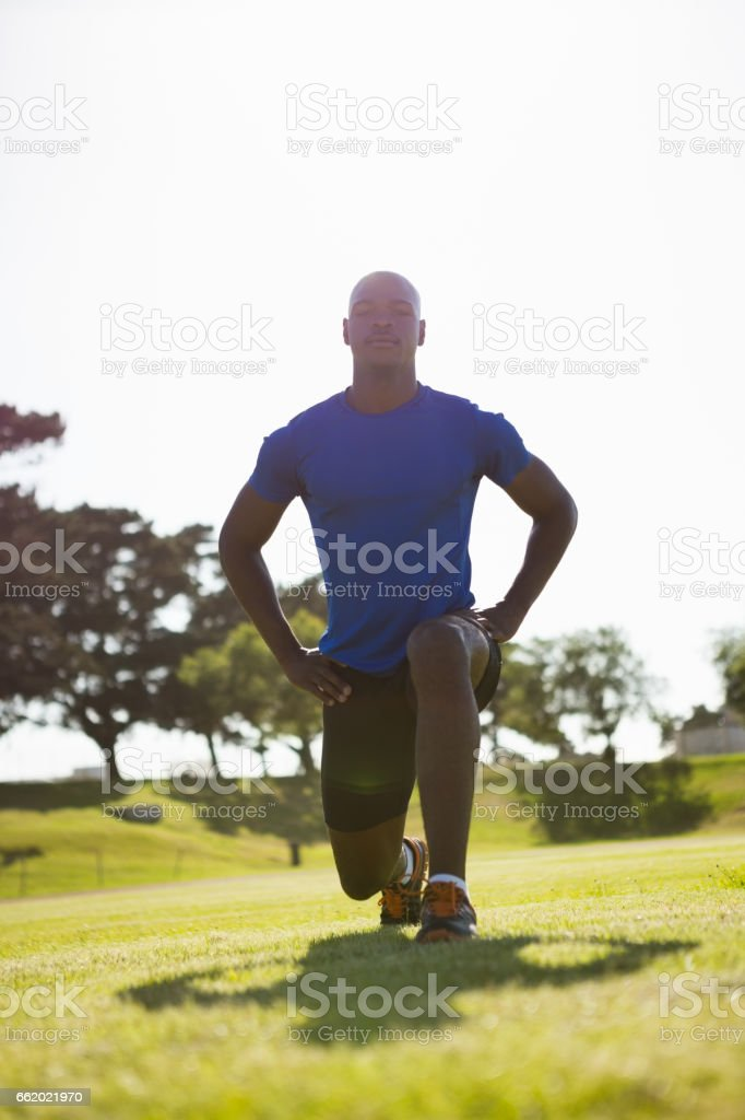 Athlete warming up in a stadium royalty-free stock photo