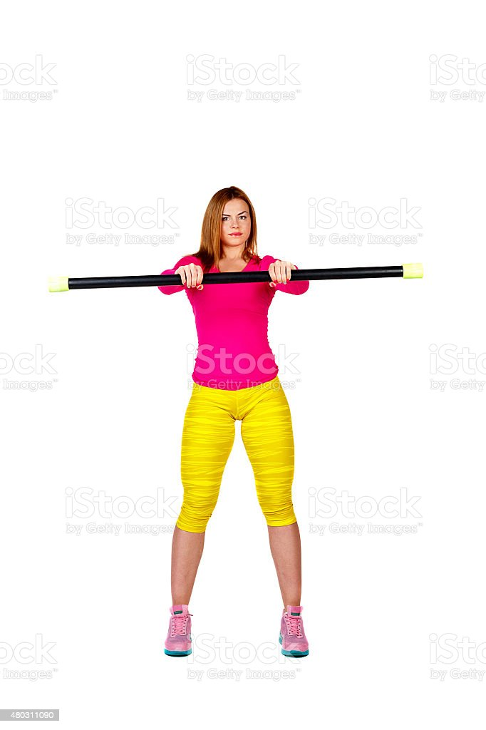 Athlete warming up with fitbar. stock photo