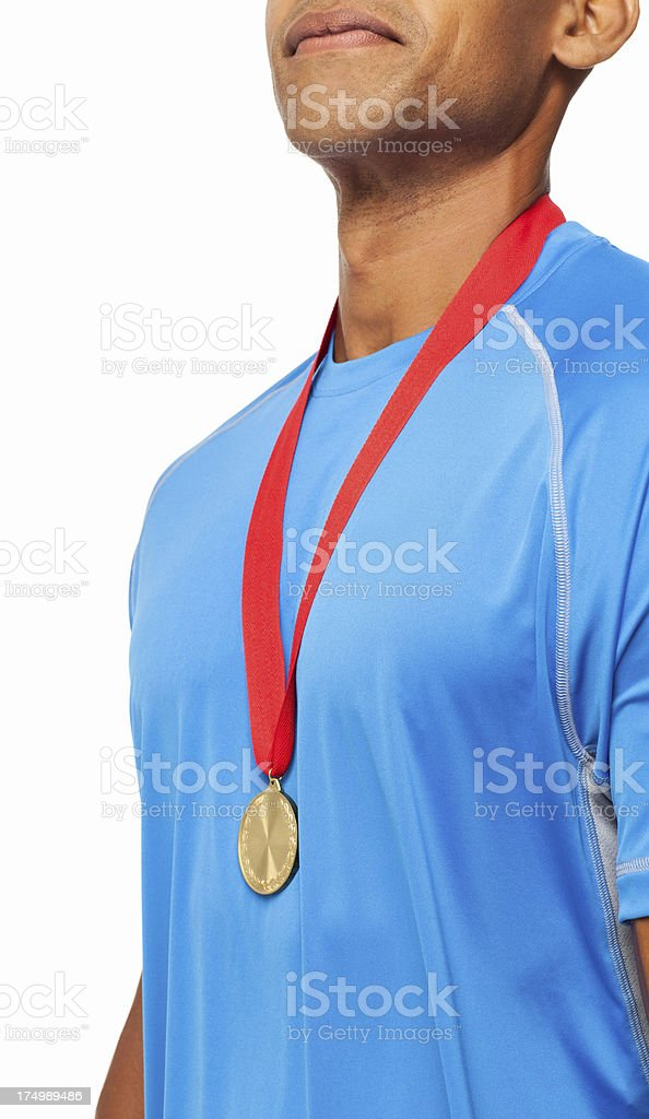 Athlete Wearing Gold Medal - Isolated royalty-free stock photo