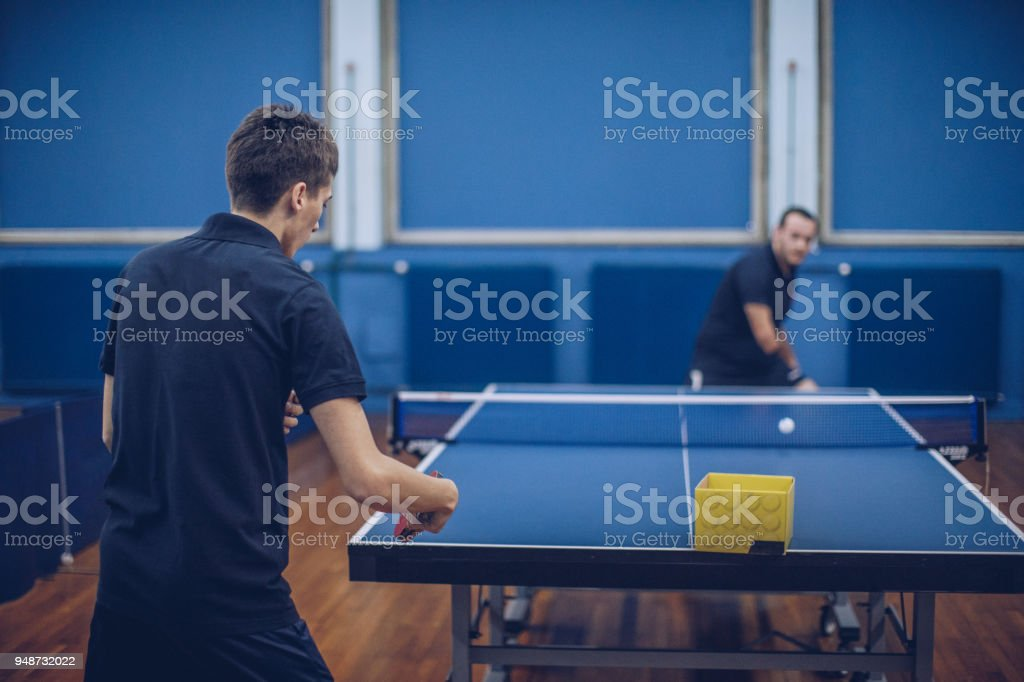 Athlete with differing abilities playing table tennis stock photo