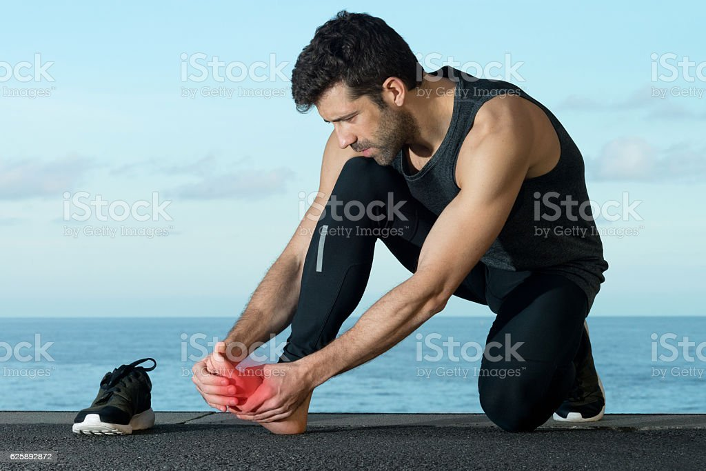 Athlete with foot injury stock photo