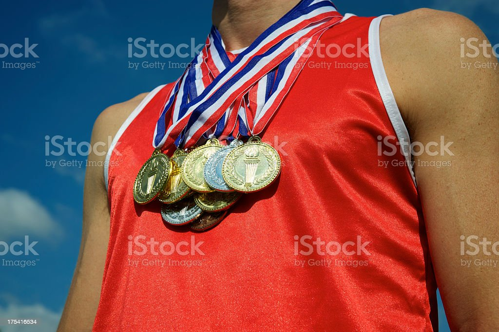 Athlete with Gold Silver Bronze Medals Bright Blue Sky royalty-free stock photo
