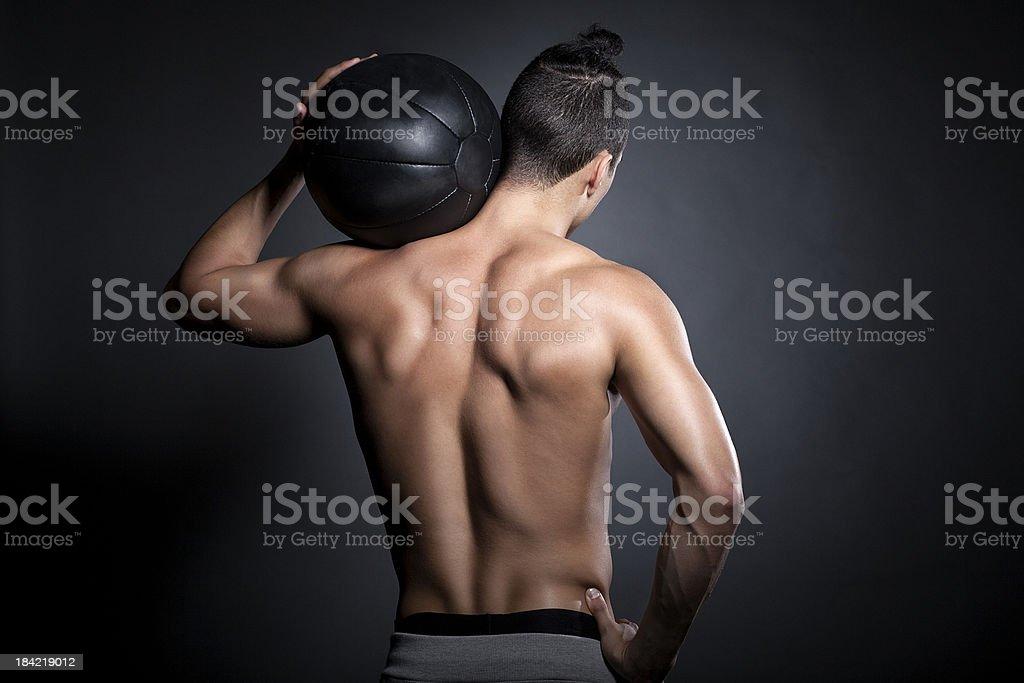 Atleta con bola de ejercicio - Foto de stock de Articulación humana libre de derechos