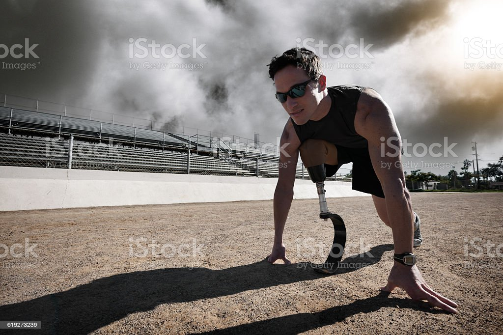 Athlete With Prosthetic Leg In Race Starting Postion stock photo