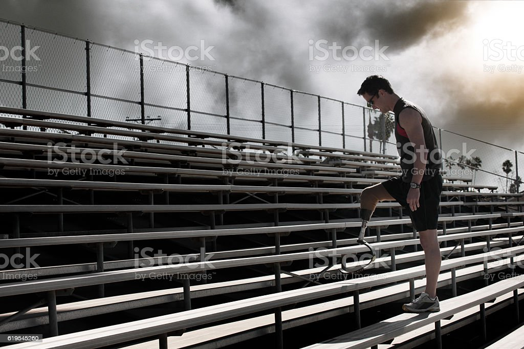 Athlete With Prosthetic Leg Running Up Stairs stock photo