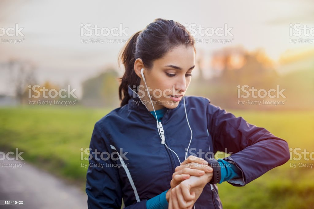 Athlete woman check smartwatch stock photo
