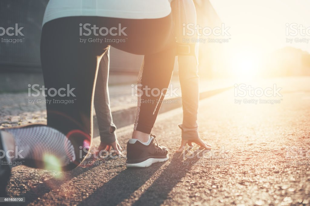 Athlete Woman In Running Start Pose Royalty Free Stock Photo