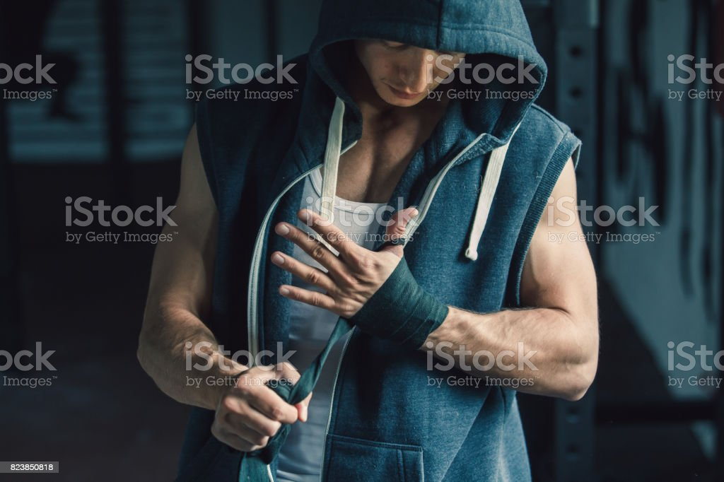 Athlete wrapping his hands before workout stock photo