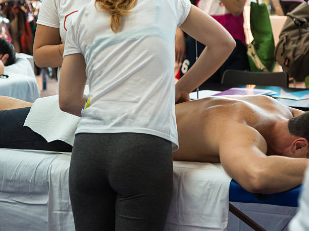Athlete's Back Massage after Fitness Activity, Wellness and Spor stock photo