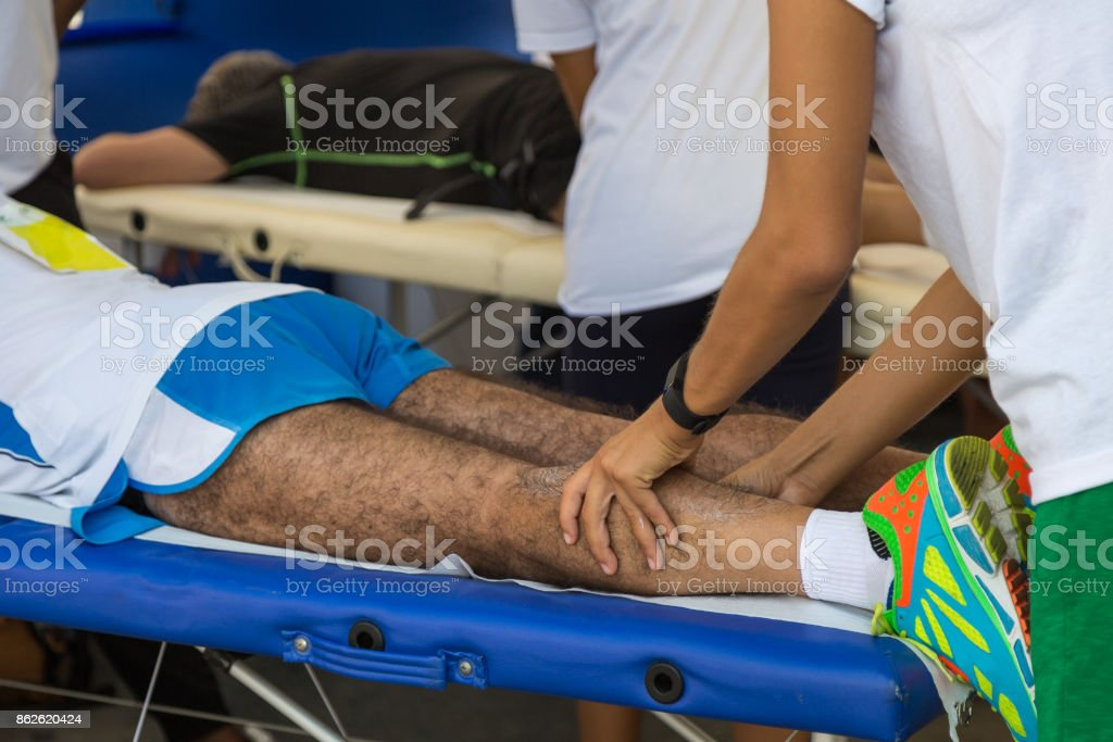 Athlete's Calf Muscle Professional Massage Treatment after Sport Workout: Fitness and Wellness stock photo