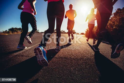 istock Athletes doing a jogging workout outdoors 514406736