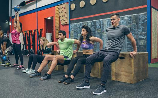 istock Athletes exercising doing box squats 1184347978