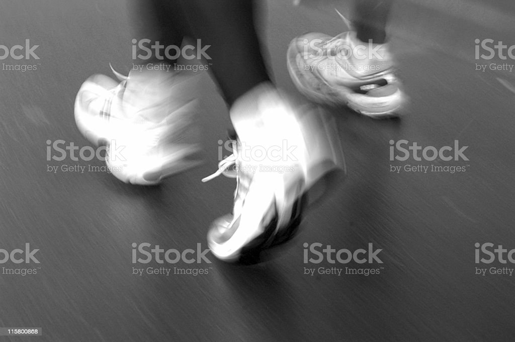 Athletes feet while running a road race stock photo