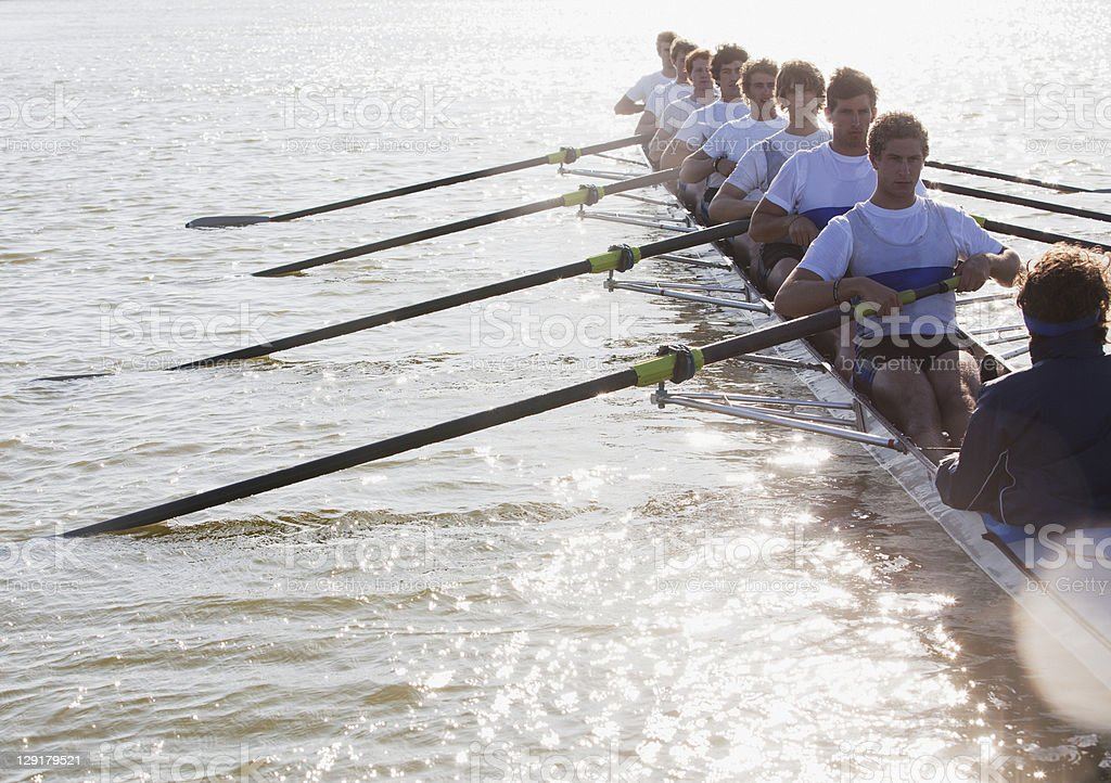 Athletes in a crew canoe royalty-free stock photo