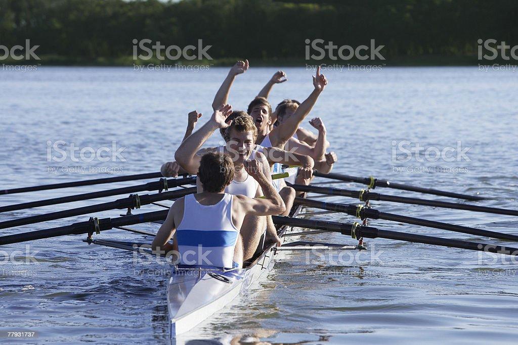 Athleten in einer crew row Boot jubeln – Foto