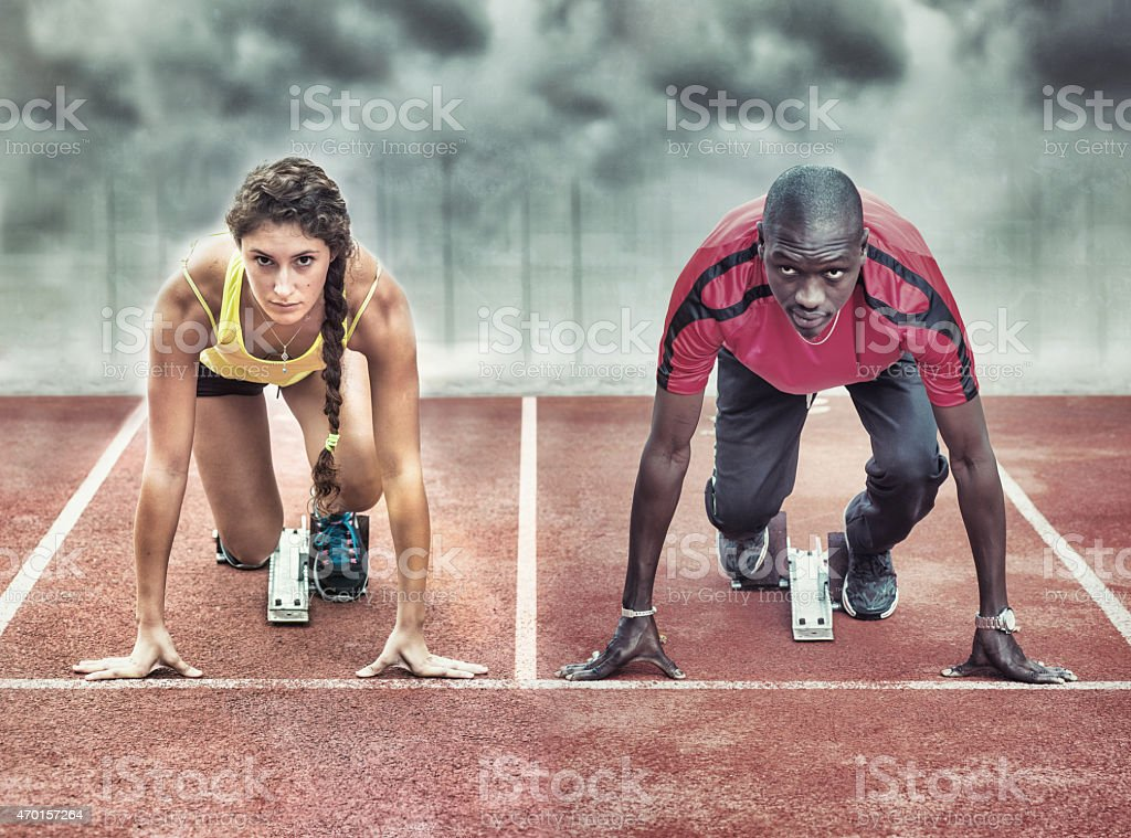 Athletes in the starting blocks stock photo