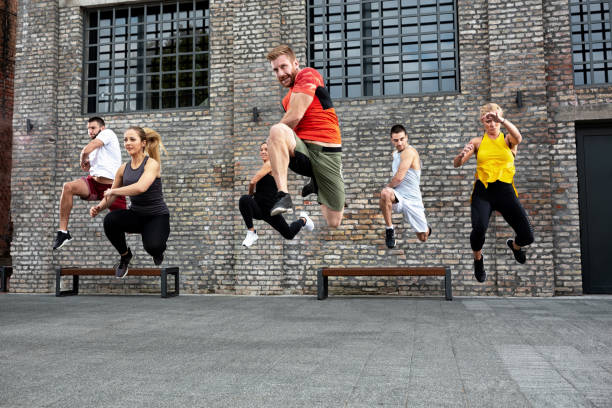 Athletes jumping during a workout session stock photo