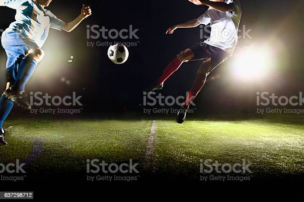 Athletes jumping towards soccer ball on field during game picture id637298712?b=1&k=6&m=637298712&s=612x612&h=yxhws6nnp yqtzdpi6b1jwv0qq53fiamii3legxojgs=