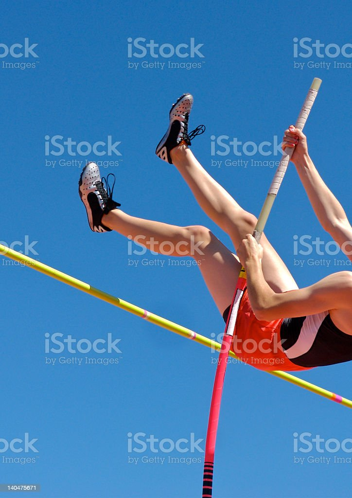 Athlete's legs jumping through the air and over mark stock photo