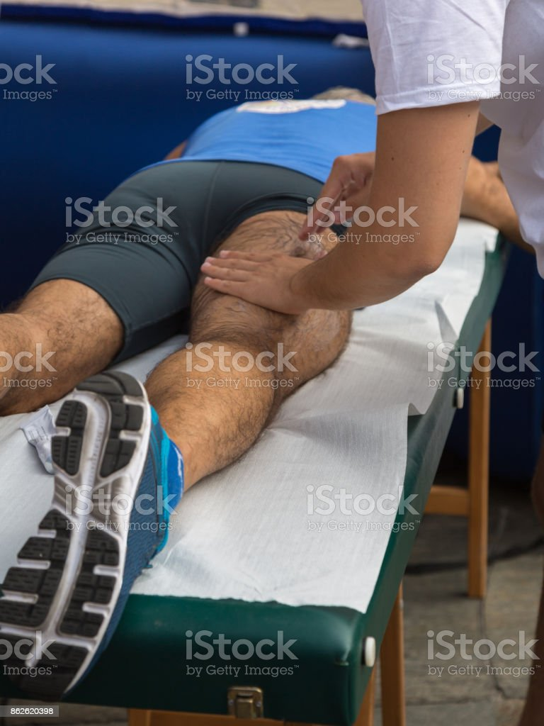 Athlete's Muscles Massage after Sport Workout stock photo