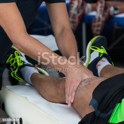 1071579572istockphoto Athlete's Muscles Professional Massage Treatment after Sport Workout, Fitness and Wellness 643350474