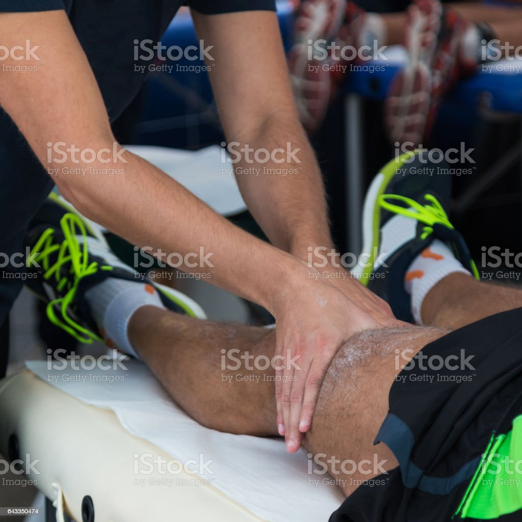 Athlete's Muscles Professional Massage Treatment after Sport Workout, Fitness and Wellness stock photo