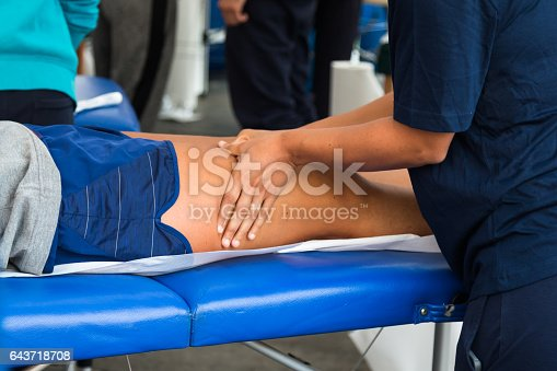 istock Athlete's Quadriceps Muscle Professional Massage Treatment after Sport Workout, Fitness and Wellness 643718708