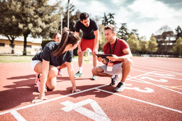 athletes reading to start on the track stock photo
