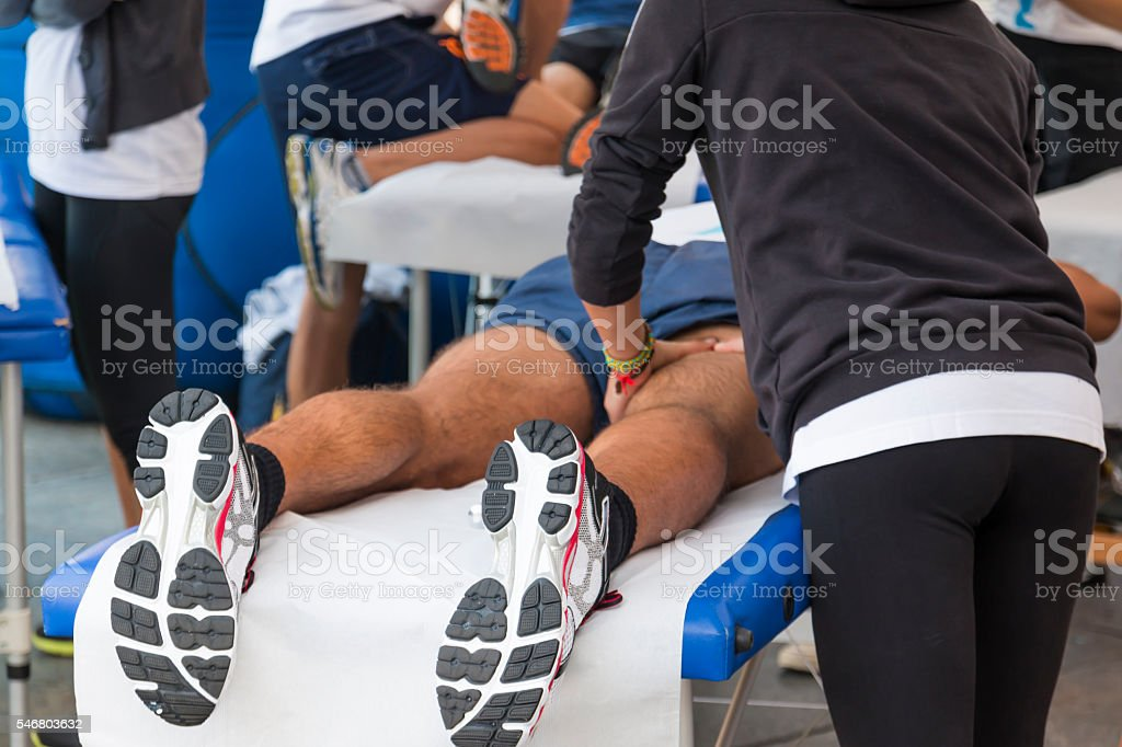 athletes relaxation massage before sport event stock photo