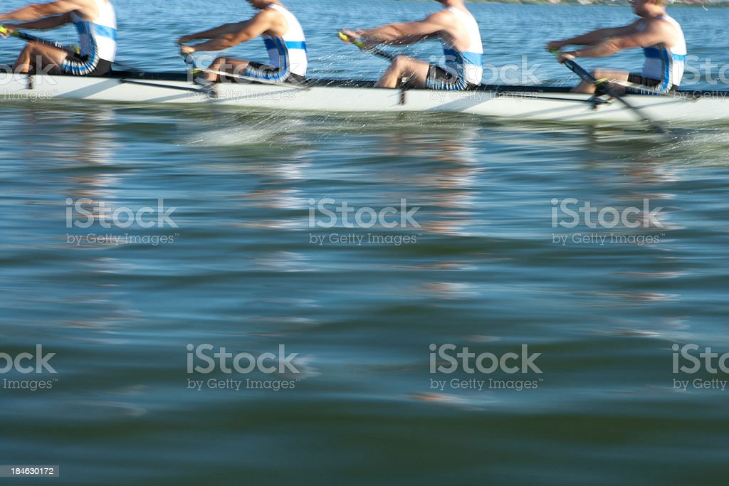 Athletes rowing a crew row boat  stock photo