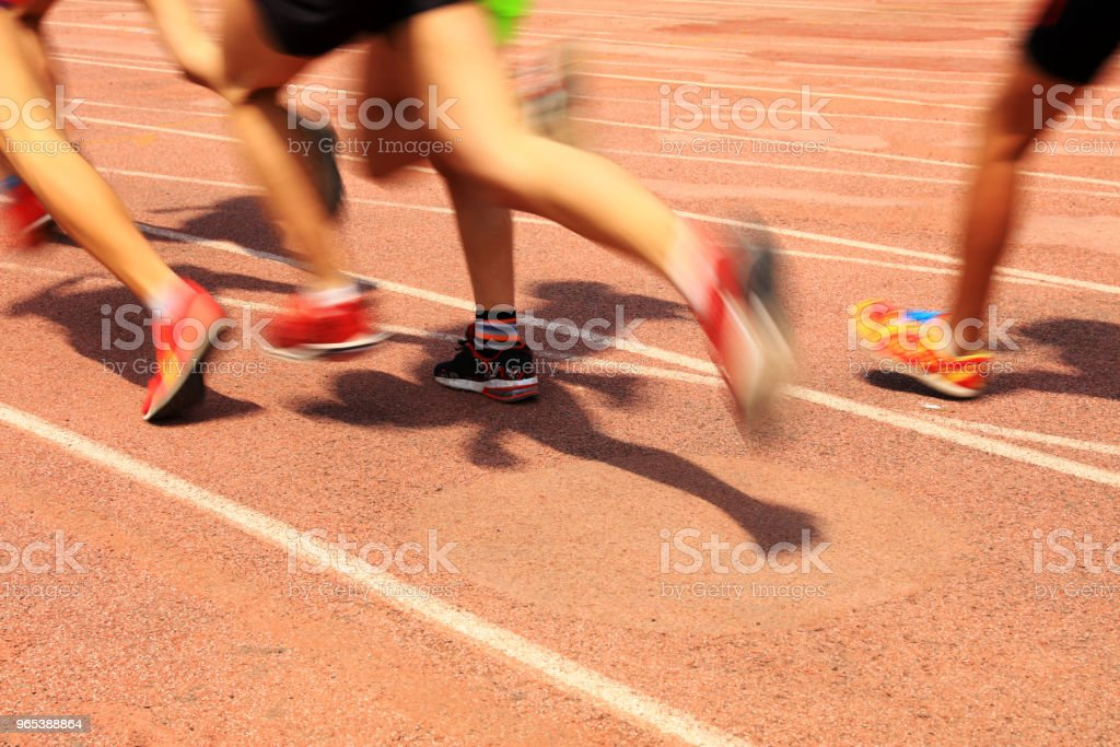 Athletes running in the playground of the runway royalty-free stock photo