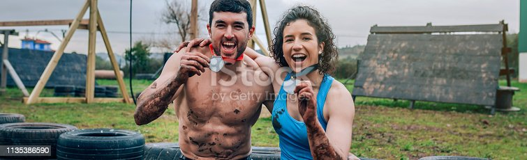 istock Athletes showing medals after race 1135386590
