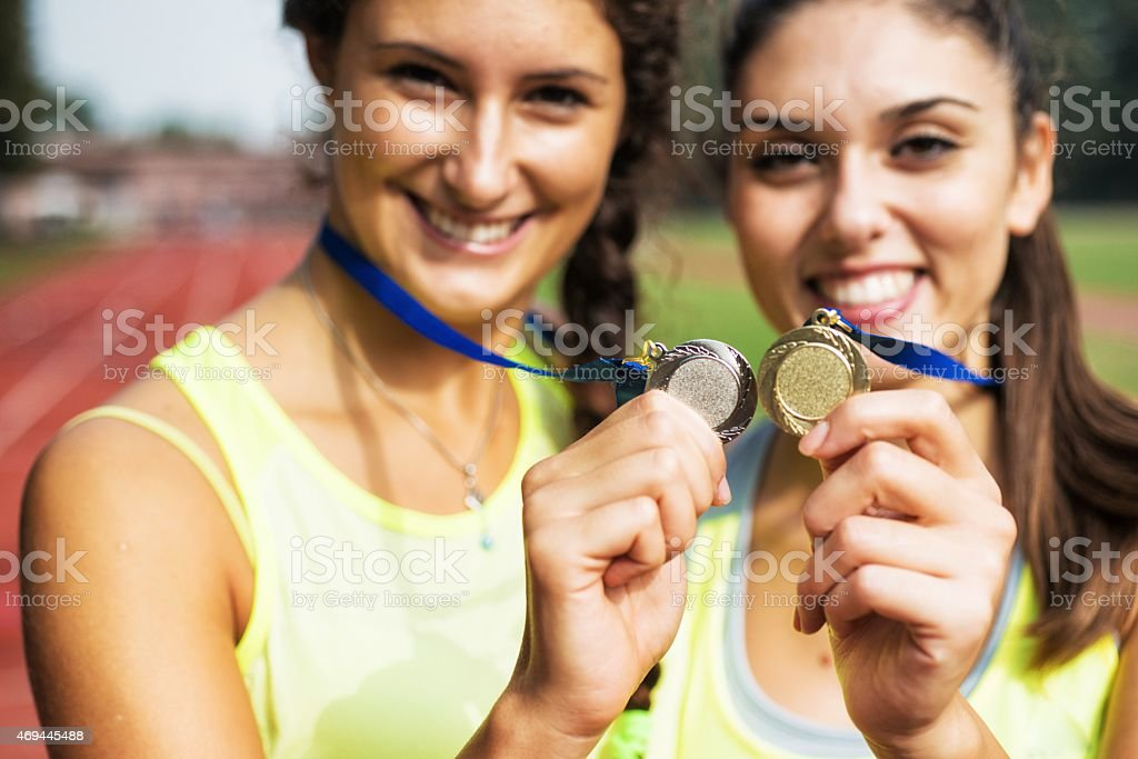 Athletes showing medals stock photo