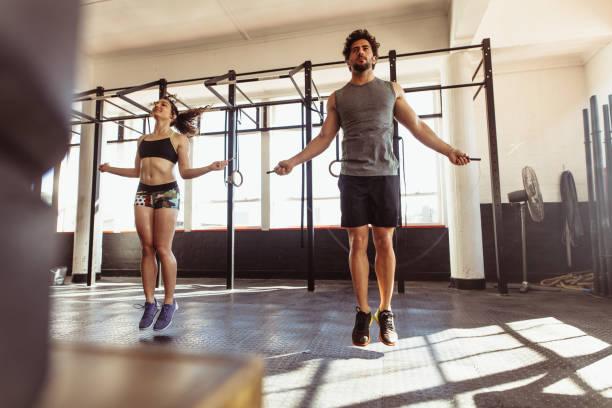 Athletes training hard at the gym stock photo