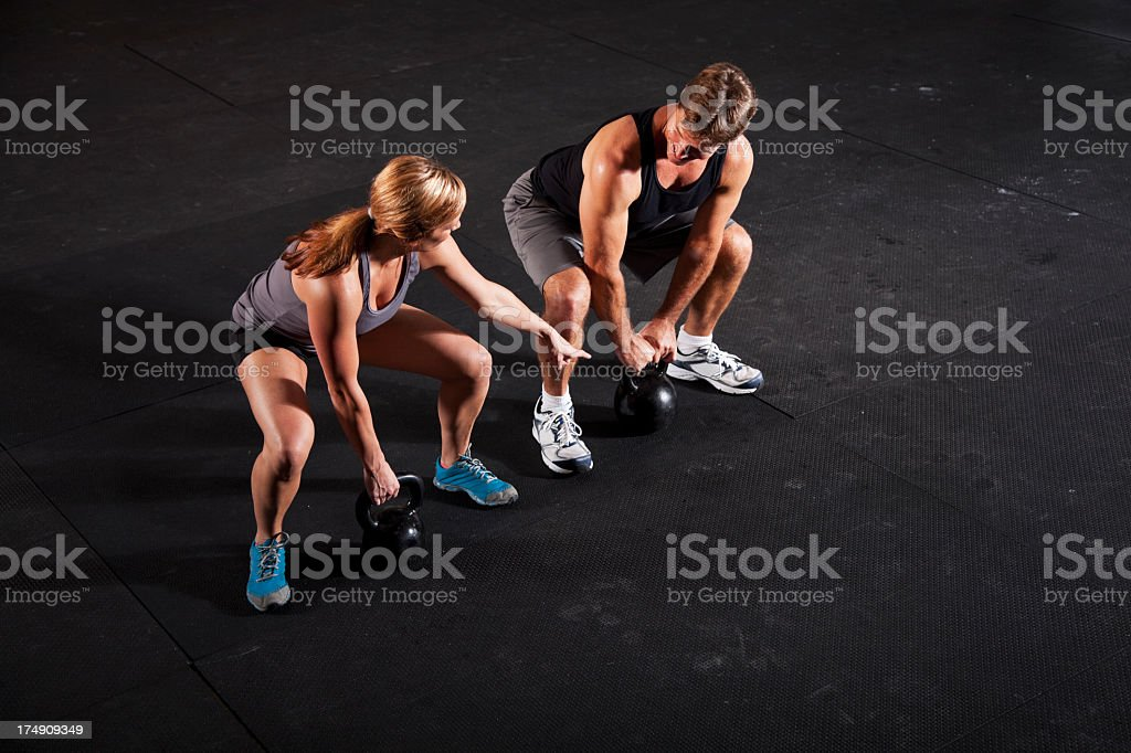 Athletes working out with kettle bells royalty-free stock photo
