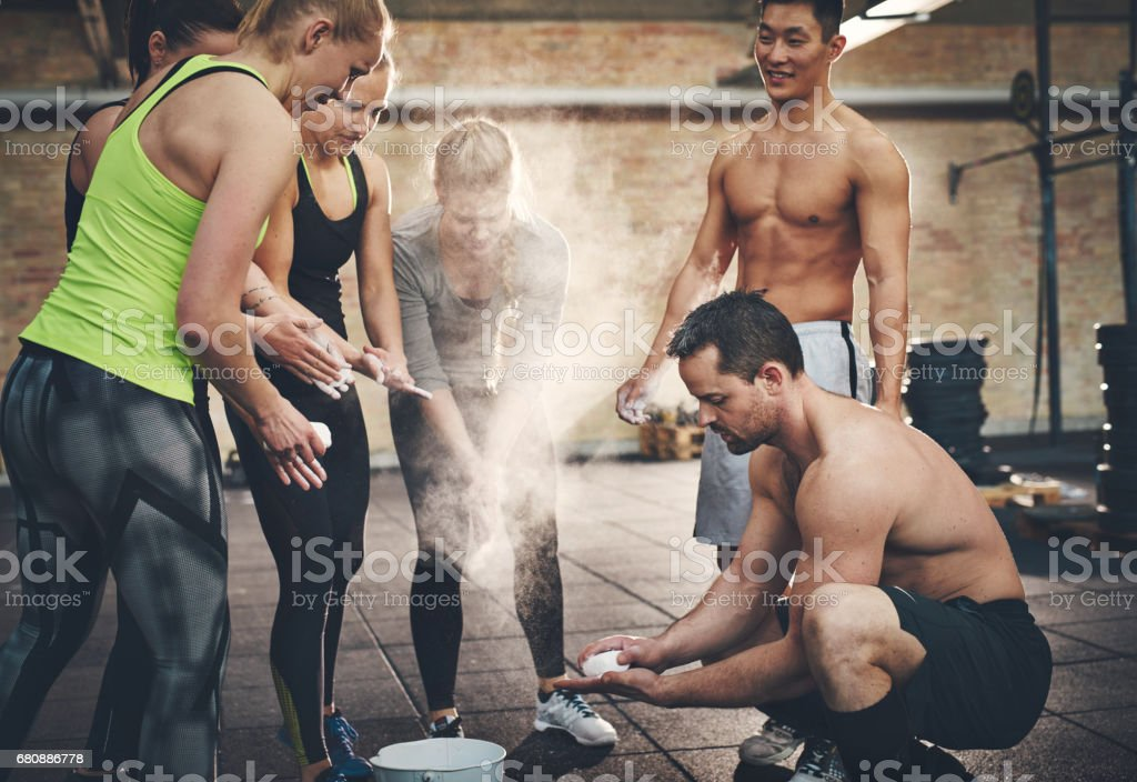 Athletic adults applying talcum powder to hands royalty-free stock photo