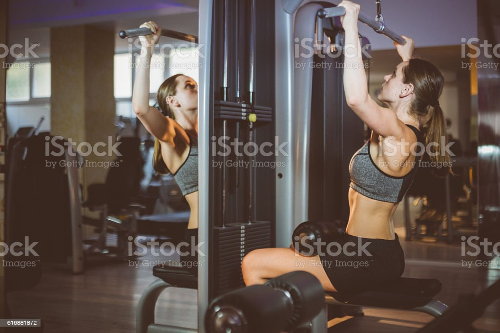 Athletic attractive girl on fitness training stock photo