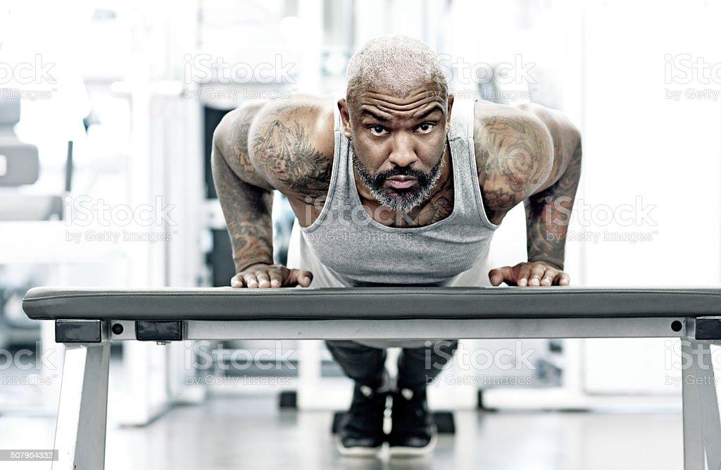 athletic black man exercising indoors stock photo
