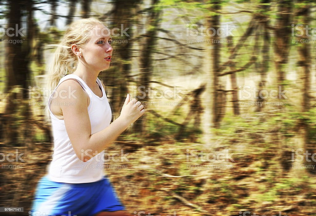Athletic Blonde Girl Running stock photo
