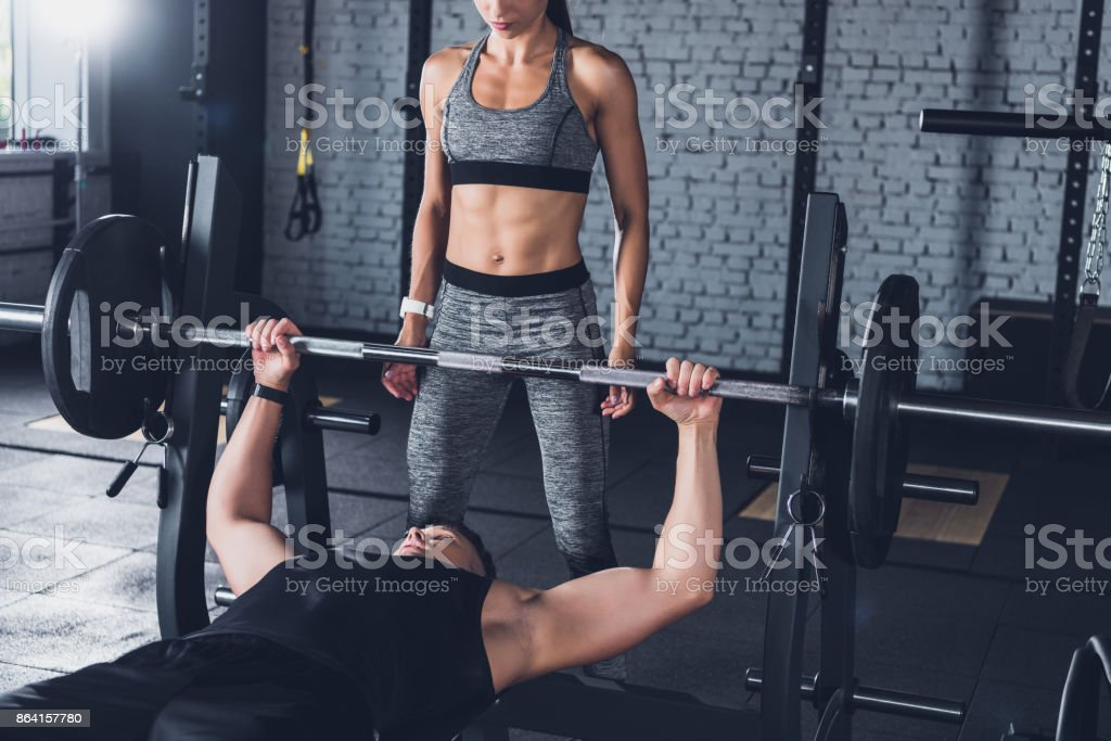 athletic couple in gym royalty-free stock photo