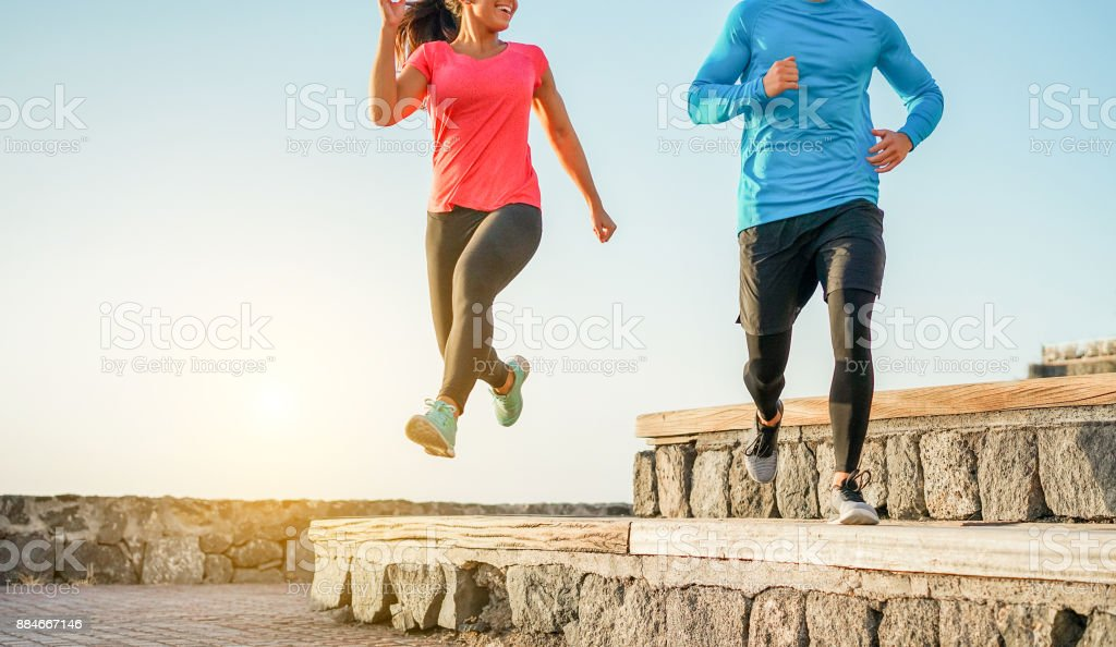 Athletic Couple Of Friends Running Outdoor Fitness Happy
