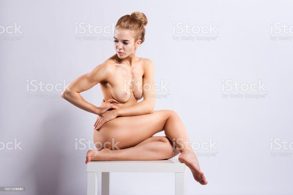 Athletic European fashion model woman  workout. Nude girl yoga pose. стоковое фото
