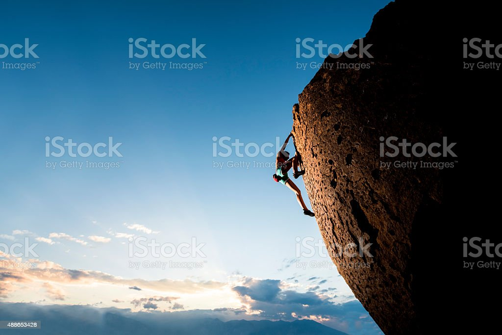 Athletic female rock climber stock photo