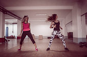 Athletic Females Working Out With Zumba Dancing Exercises In Gym