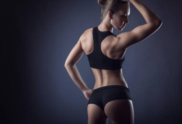 athletic figure - taillentrainer stock-fotos und bilder