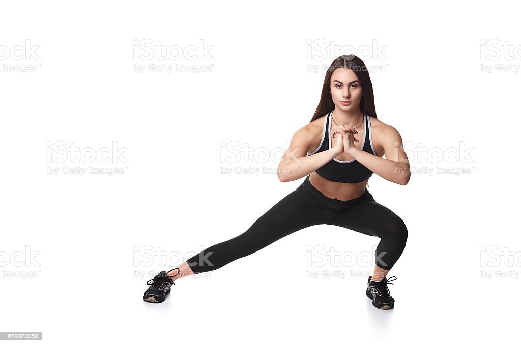 Athletic fitness woman helthy sport isolated white background black clothes stock photo