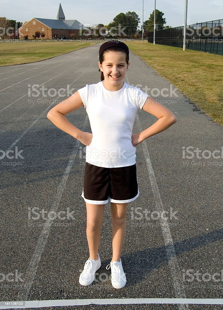 Athletic girl on a track royalty-free stock photo