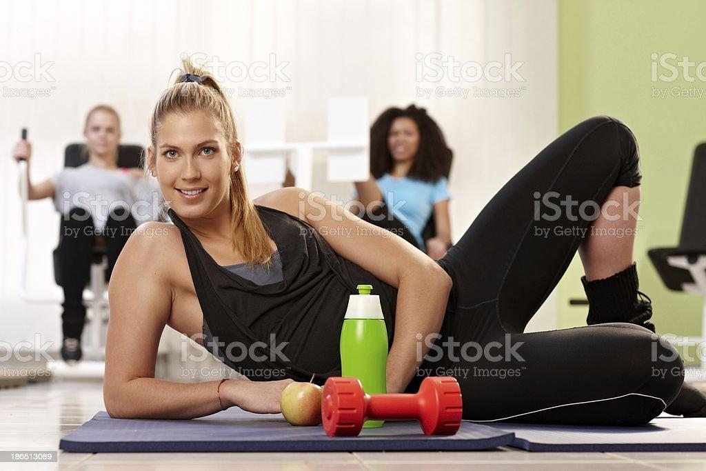 Athletic girl posing at health club royalty-free stock photo