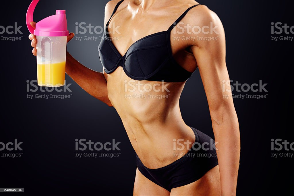 athletic girl with a vitamin drink stock photo