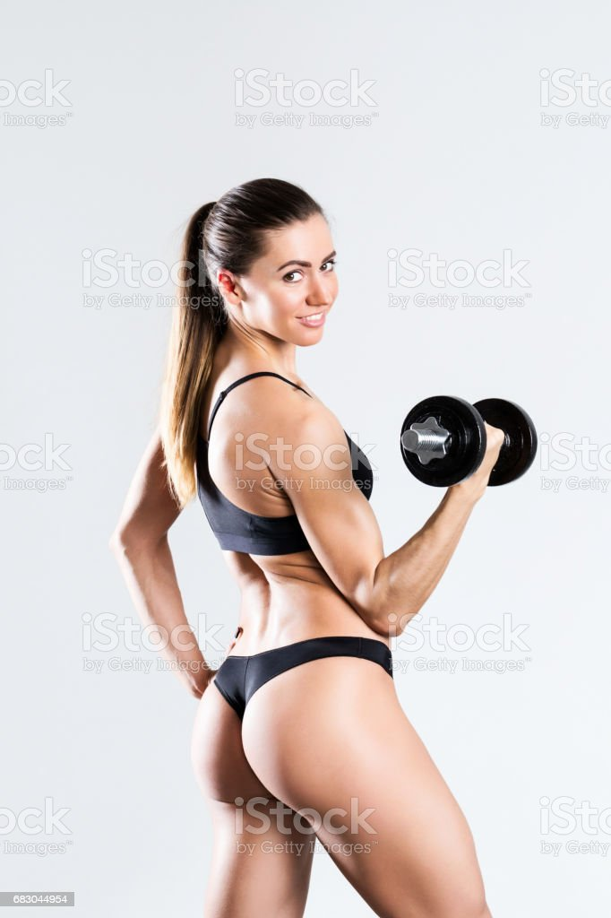 Athletic girl with dumbbells on a white background. foto de stock royalty-free